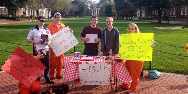 Members of the University of Delaware Students for the Second Amendment Club state their case on campus