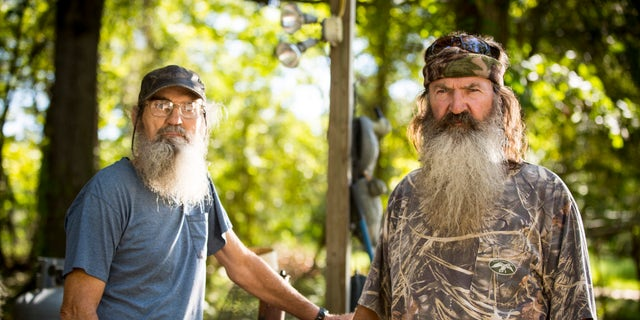 """This undated image released by A&E shows brothers Silas """"Uncle Si"""" Robertson, left, and Phil Robertson from the popular series """"Duck Dynasty."""""""