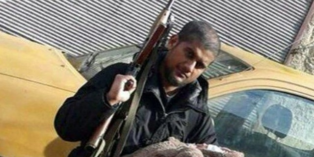 Siddhartha Dhar tweeted this photo of himself holding a rifle with his baby son.