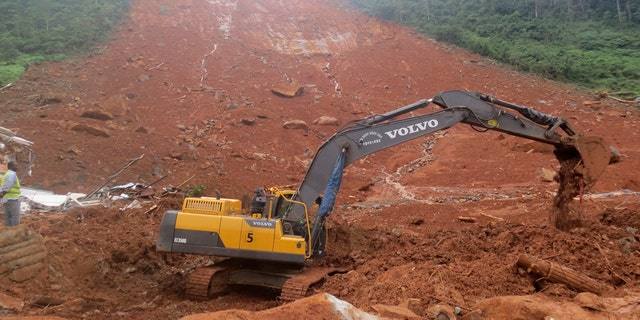 Heavy equipment is used as rescue workers search for survivors and victims following a mudslide in Regent, east of Freetown, Sierra Leone, Monday, Aug. 14, 2017.