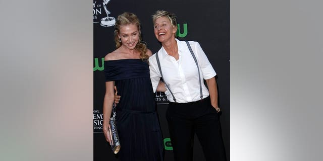 ** CORRECTS TO ROSSI **Ellen DeGeneres, right, and Portia de Rossi arrive at the Daytime Emmy Awards on Sunday Aug. 30, 2009, in Los Angeles. (AP Photo/Matt Sayles)