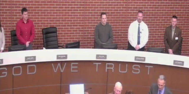 "The display of ""In God We Trust"" motto on the Wentzville council podium sparked protests from anti-religion groups."