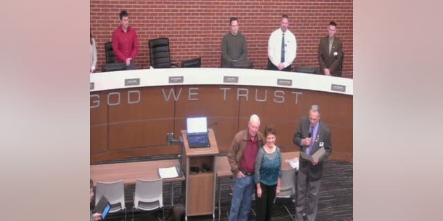 """The display of """"In God We Trust"""" motto on the Wentzville council podium sparked protests from anti-religion groups."""