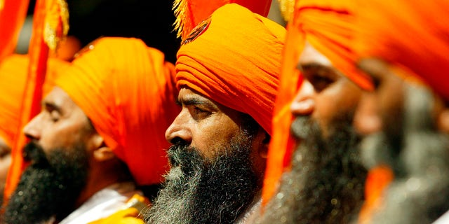 Sikh men march down Broadway during the annual Sikh Day parade in New York, April 19, 2003. The Sikh religion has a following of over 20 million people worldwide and is ranked as the worlds 5th largest religion. REUTERS/Shannon Stapleton  SS/HB - RTRM3CF