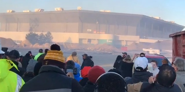 Onlookers watch the planned implosion at the Pontiac Silverdome in Michigan.