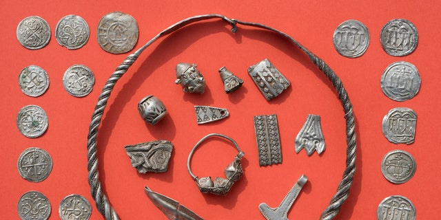 Jewelry and coins found near Schaprode on the northern German island of Ruegen in the Baltic Sea. (Stefan Sauer/dpa via AP)