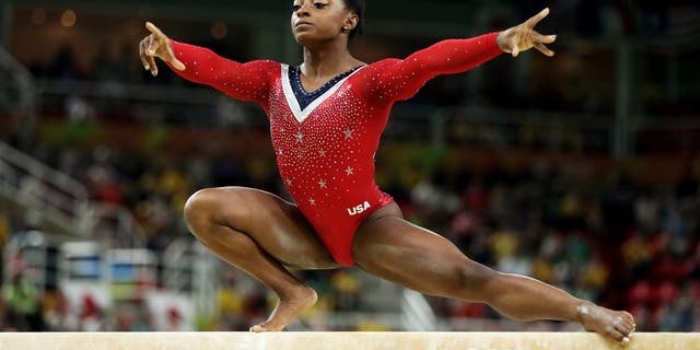 RIO DE JANEIRO, BRAZIL - AUGUST 15: Simone Biles of the United States competes in the Balance Beam Final on day 10 of the Rio 2016 Olympic Games at Rio Olympic Arena on August 15, 2016 in Rio de Janeiro, Brazil. (Photo by Lars Baron/Getty Images)