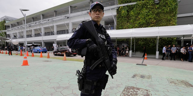 A police officer guards the entrance of the international media center in Singapore ahead of the June 12 summit between U.S. President Donald Trump and North Korean leader Kim Jong Un, June 10, 2018.