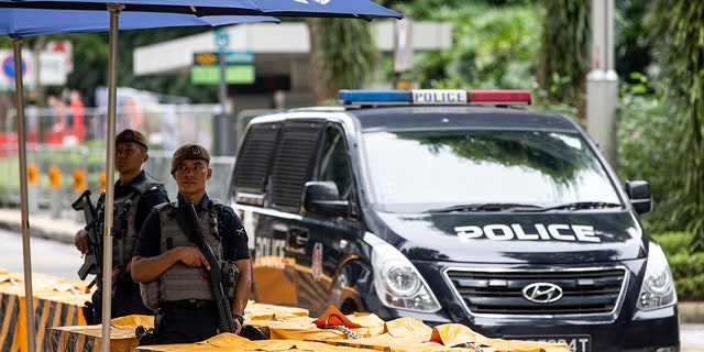 Gurkha police officers stand guard outside the St. Regis Hotel in Singapore ahead of the June 12 summit between U.S. President Donald Trump and North Korean leader Kim Jong Un, June 10, 2018.