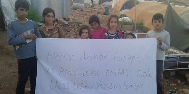 Yazidi Children at a camp in Mt. Sinjar also made signs with a direct message to the President.