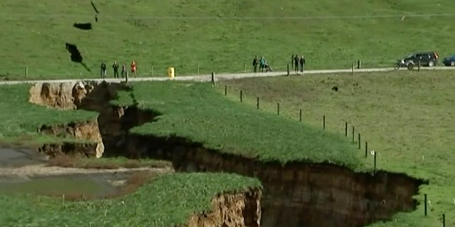 This image made from the May 2, 2018 video shows huge sinkhole on farm in Rotorua, New Zealand. (Newshub via AP Video)