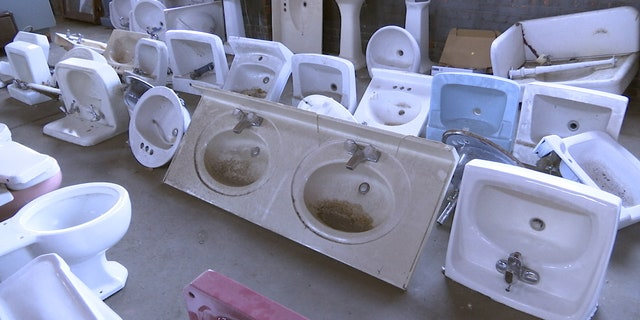 Various vintage bathroom sinks for sale at Rescued Relics in Montgomery, Ala.