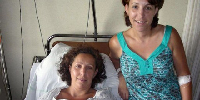 Karine Thiriot (L) and her twin sister Stephanie.