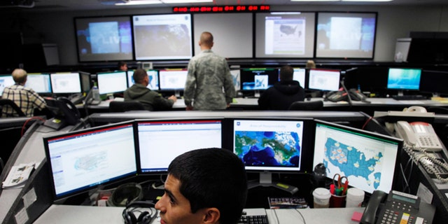 July 20, 2010: Lt William Liggett works at the Air Force Space Command Network Operations & Security Center at Peterson Air Force Base in Colorado Springs, Colorado.