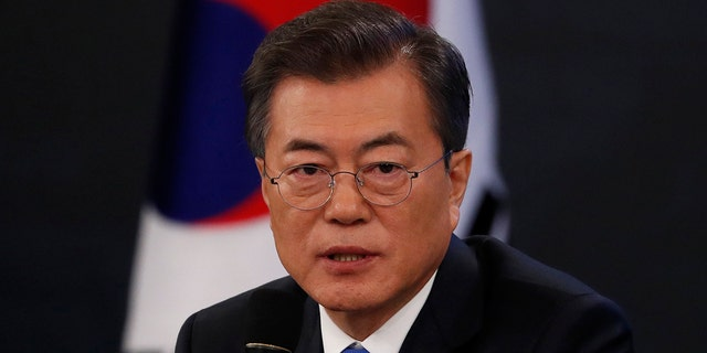 South Korean President Moon Jae-in answers reporters' question during his New Year news conference at the Presidential Blue House in Seoul