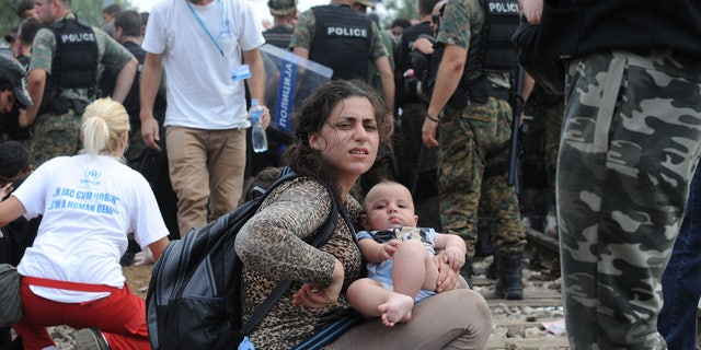 Macedonian volunteers and police with refugees in Gevgelija, near the border of Macedonia and Greece. (FoxNews.com)