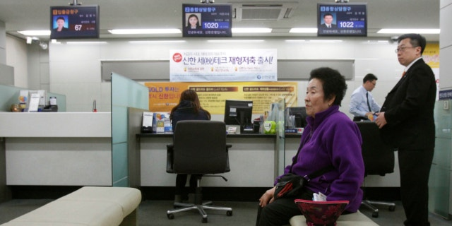 March 20, 2013: A customer sits in a branch of Shinhan Bank in Seoul, South Korea, while the bank's computer networks are paralyzed.