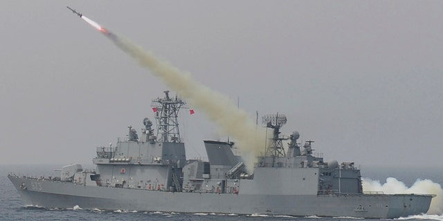 A South Korean navy ship fires a missile during a drill in South Korea's East Sea Thursday.