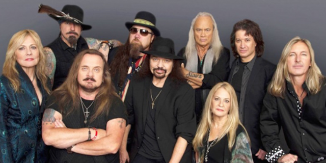 Members of the most recent lineup of Lynyrd Skynyrd, including lead singer Johnny Van Zant (front, second from left) and guitarist Gary Rossington (center).