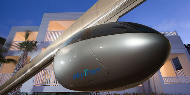 SkyTran's levitating transit pods will carry passengers over street traffic to their destinations.