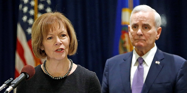 Smith, seen here with Minnesota Gov. Mark Dayton, was named to fill Al Franken's seat.