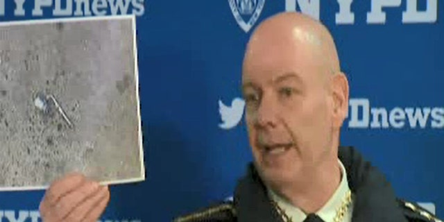 """NYPD Chief of Department Terence Monahan at a press conference on Wednesday showing what 911 callers had described as a """"silver firearm"""" that a man was pointing at people on the street."""