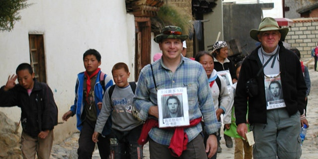 The Sneddon family, pictured, made several visits to China to look for their son.