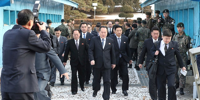 The head of North Korean delegation Ri Son Gwon, center, arrives at the South side for the meeting with South Korea at the Panmunjom in the Demilitarized Zone in Paju, South Korea, Tuesday, Jan. 9, 2018.
