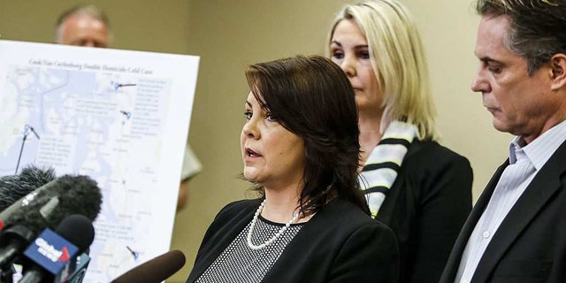 Laura Baanstra, a sister of 1987 homicide victim Jay Cook, speaks at a news conference held, in Everett, Wash. on Wednesday, to release DNA-generated composite images of the suspect.