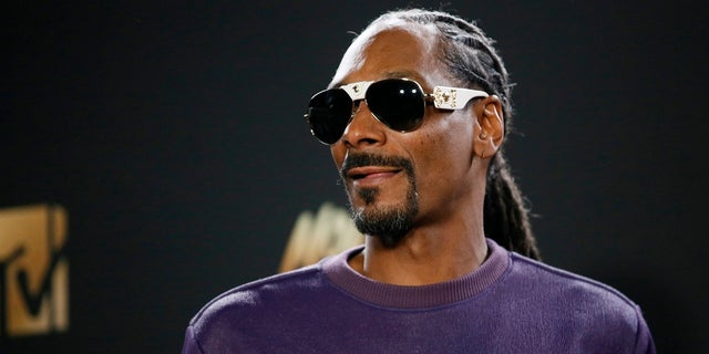"Rapper Snoop Dogg is seen in a video saying, ""F--- the President."""
