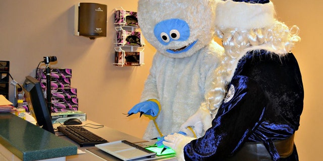 The department joked that Snowman, seen here being fingerprinted, is scheduled to appear in court for his drunk driving charges on Dec. 20.