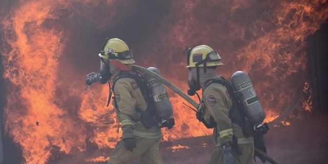 Firefighters respond to wildfires in Southern California.