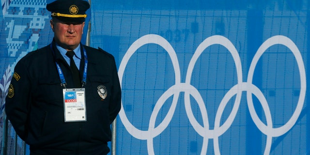 Feb. 2, 2014: A  security guard stands at Olympic Park in Sochi, Russia. Sochi will host the 2014 Winter Olympic Games from Feb. 7 to Feb. 23.