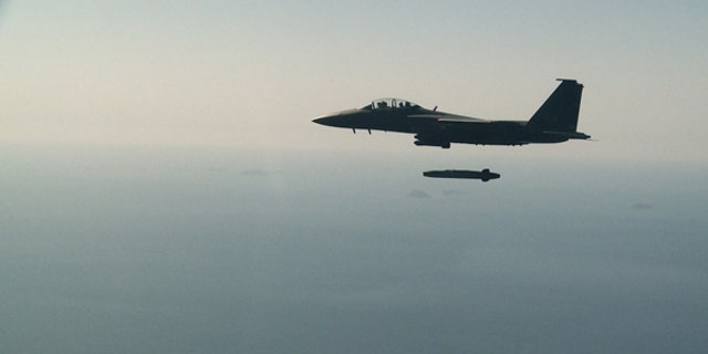 A South Korean air force F-15K fighter jet releases a Taurus missile during a drill off the country's western coast, Sept. 13, 2017.