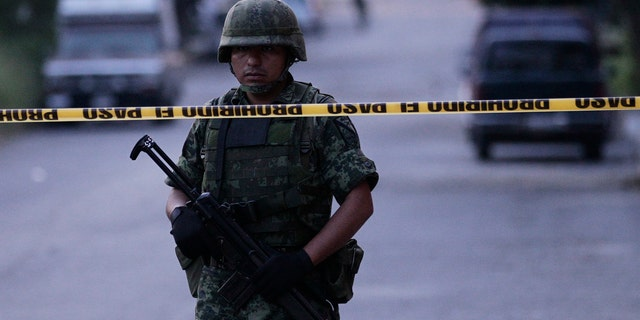 A soldier stands in Ciudad Victoria, in the Mexican state of Tamaulipas