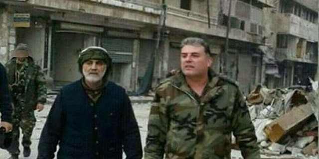 A photo recently surfaced on social media that shows the head of Quds Forces, Qasem Soleimani surveying the streets Aleppo with his Russian counterpart.