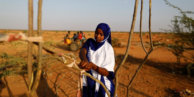 Zeinab, 14, helps her mother and sister build a new shelter at a camp for internally displaced people from drought hit areas in Dollow, Somalia April 2, 2017.