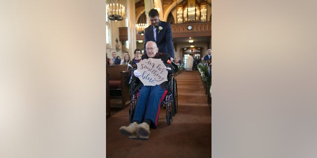 Bill Lee Eblen, 92, was wheeled down the aisle of his niece's wedding in Cape Girardeau, Missouri, after recovering from an illness.