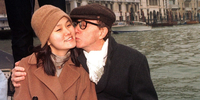 Woody Allen kisses his now-wife Soon-Yi Previn, the adopted daughter of his former lover Mia Farrow, in a gondola in Venice's Grand Canal on December 24, 1997.