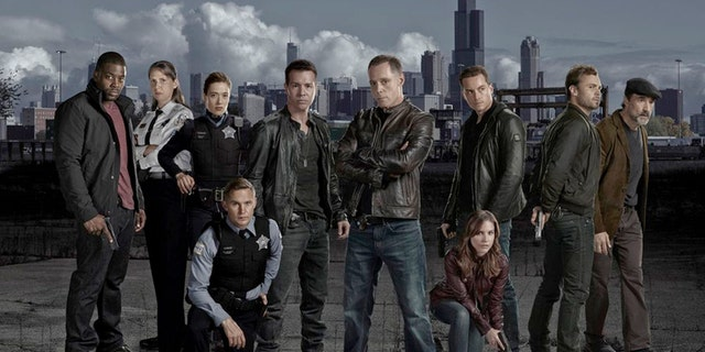 Pictured: (l-r) LaRoyce Hawkins as Detective Kevin Atwater, Amy Morton as Sgt. Trudy Platt, Marina Squerciati as Officer Kim Burgess, Brian Geraghty as Officer Sean Roman, Jon Seda as Det. Antonio Dawson, Jason Beghe as Sgt. Hank Voight,  Sophia Bush as Det. Erin Lindsay, Jesse Lee Soffer as Det. Jay Halstead, Patrick Flueger as Det. Adam Ruzek,  Elias Koteas as Det. Alvin Olinksy.