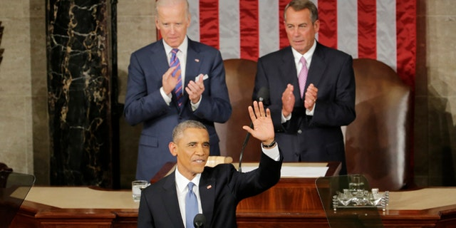 Jan. 20, 2015: President Barack Obama waves before giving his State of the Union address before a joint session of Congress on Capitol Hill in Washington. (AP)