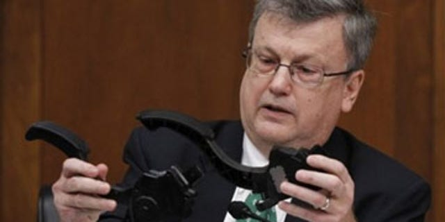 Feb. 24: House Oversight and Government Reform Committee member Rep. Mark Souder, R-Ind., holds two Toyota accelerator pedals while asking a question of Toyota President and Chief Executive Officer Akio Toyoda, on Capitol Hill in Washington. (AP Photo)