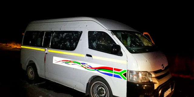 A minibus with bullet holes on its side is seen on the road between Weenen and Colenso, in KwaZulu Natal province, South Africa, early Sunday, July 22, 2018.