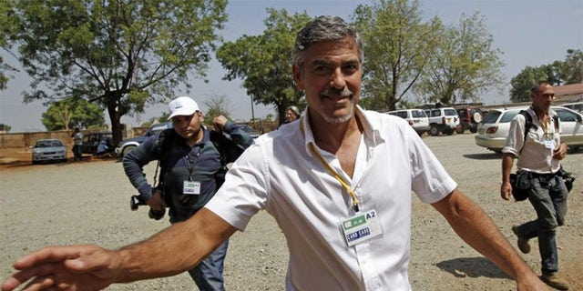 George Clooney walks in front of St. Teresa's Cathedral during the independence referendum in Juba, South Sudan Jan. 9, 2011.