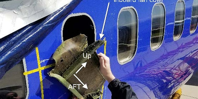 """The National Transportation Safety Board's findings show, among other things, a gouge near the plane's shattered window """"consistent in shape to a recovered portion of fan cowl and latching mechanism."""