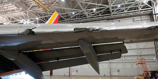 """The NTSB shared a photo of """"significant"""" damage caused to the left wing of the aircraft."""