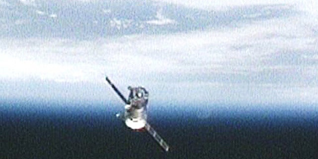 The Soyuz TMA-17 spacecraft carrying Expedition 23 Commander Oleg Kotov and Flight Engineers T.J. Creamer and Soichi Noguchi moves away from the International Space Station after undocking on June 1, 2010 in this view from an exterior station camera.
