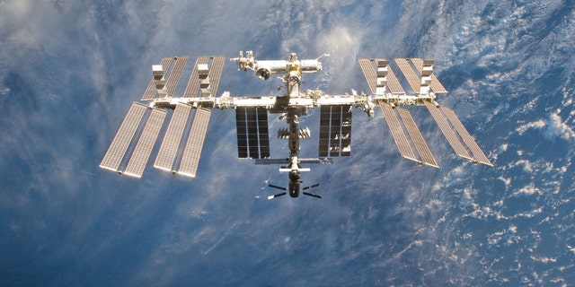 File photo - The International Space Station is seen in this view from the space shuttle Discovery after the undocking of the two spacecraft in this photo provided by NASA and taken March 7, 2011.