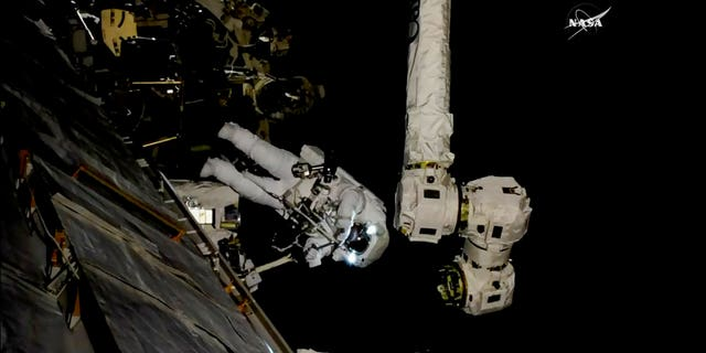 In this frame from NASA TV, Astronaut Mark Vande Hei works on the International Space Station on Thursday, Oct. 5, 2017. Hei and Randy Bresnik went out on a spacewalk to give the International Space Station's big robot arm a new hand.
