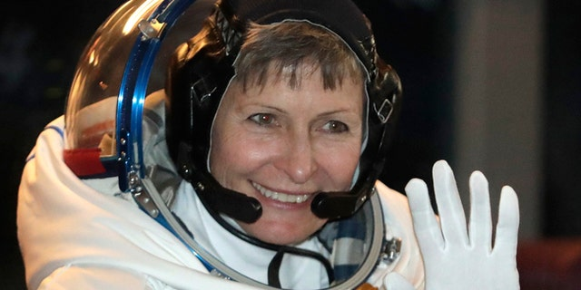 U.S. astronaut Peggy Whitson, member of the main crew of the expedition to the International Space Station, waves from a bus prior to the launch of Soyuz MS-3 spaceship.